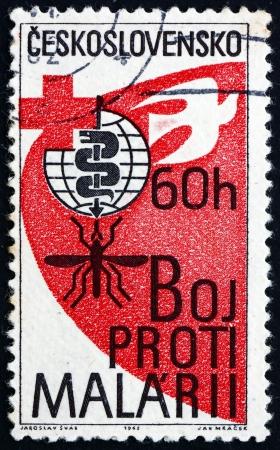 CZECHOSLOVAKIA - CIRCA 1962: a stamp printed in the Czechoslovakia shows Malaria Eradication Emblem, Cross and Dove, WHO Drive to Eradicate Malaria, circa 1962 Stock Photo - 17523431