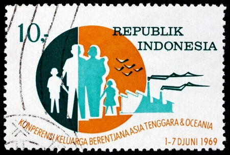 INDONESIA - CIRCA 1969: a stamp printed in Indonesia shows Family, Birds and Factories, Planned Parenthood Conference of Southeast Asia and Oceania, Bandung, circa 1969 Stock Photo - 17523471