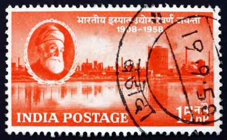 steel works: INDIA - CIRCA 1958: a stamp printed in India shows Jamsetji Nusserwanji Tata and Steel Works, Jamshedpur, 50th Anniversary of Indian Steel Industry, circa 1958