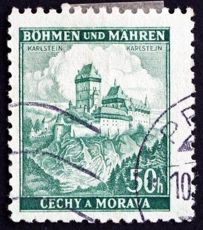 czechoslovakia: CZECHOSLOVAKIA - CIRCA 1939: a stamp printed in the Czechoslovakia shows View of the Karlstein Castle, Bohemia and Moravia, circa 1939