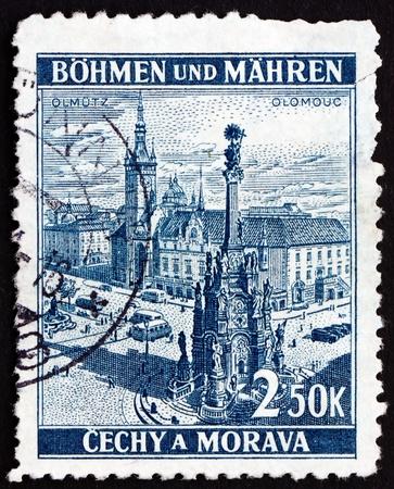 olomouc: CZECHOSLOVAKIA - CIRCA 1939: a stamp printed in the Czechoslovakia shows Holy Trinity Column and Olomouc Town Hall, Town Square, Olomouc, Bohemia and Moravia, circa 1939