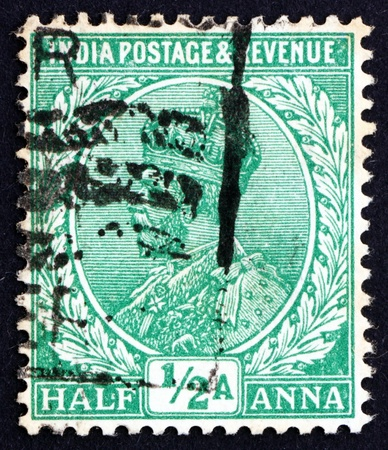 indian postal stamp: INDIA - CIRCA 1934: a stamp printed in India shows King George V, Emperor of India, circa 1934