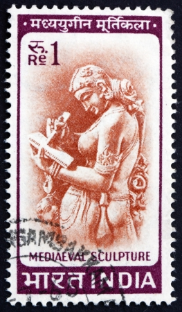 indian postal stamp: INDIA - CIRCA 1966: a stamp printed in India shows Woman Writing Letter, Chandella Carving, 11th Century, circa 1966