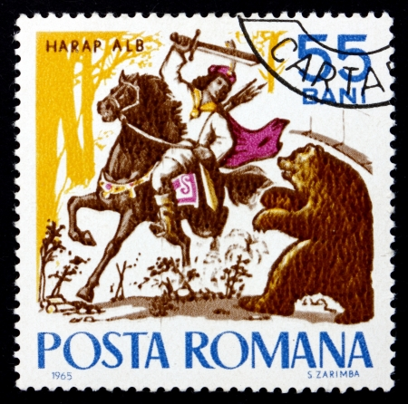 ROMANIA - CIRCA 1965: a stamp printed in the Romania shows Harap Alb and the Bear, Fairy Tale, circa 1965 Stok Fotoğraf - 17838640