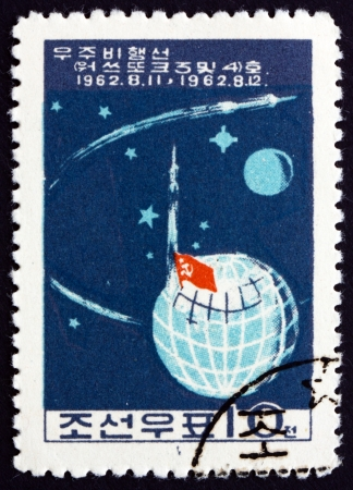 manned: NORTH KOREA - CIRCA 1962: a stamp printed in North Korea shows Launch of Soviet Manned Rockets Vostok 3 and Vostok 4, circa 1962