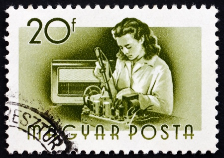 the assembler: HUNGARY - CIRCA 1955: a stamp printed in the Hungary shows Radio Assembler, Profession, circa 1955