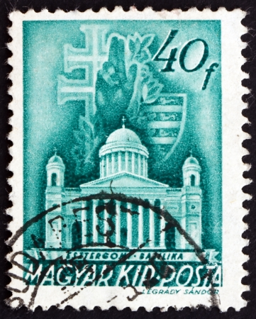 HUNGARY - CIRCA 1939: a stamp printed in the Hungary shows The Primatial Basilica of the Blessed Virgin Mary Assumed into Heaven and St. Adalbert, Esztergom, Budapest, circa 1939 Stock Photo - 17950662