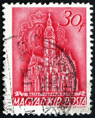 HUNGARY - CIRCA 1939: a stamp printed in the Hungary shows The Coronation Church of Our Lady, Matthias Church, Budapest, circa 1939 Stock Photo - 17950670