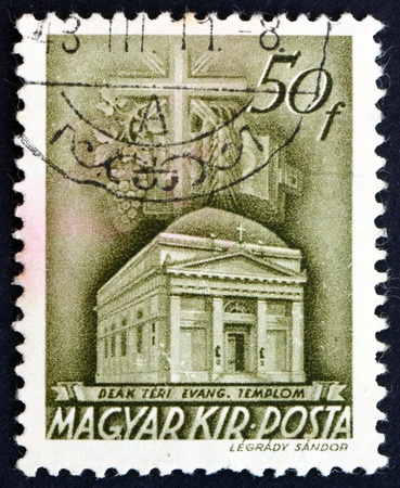 HUNGARY - CIRCA 1939: a stamp printed in the Hungary shows Deak Square Evangelical Church, Budapest, circa 1939 Stock Photo - 17950669