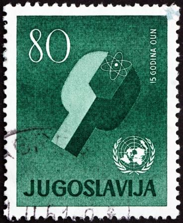 un used: YUGOSLAVIA - CIRCA 1960: a stamp printed in the Yugoslavia shows Atom and UN Emblem, 15th Anniversary of UN, circa 1960 Editorial