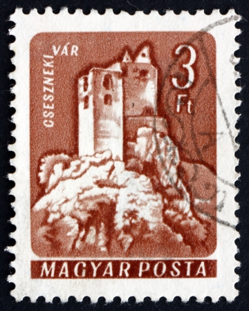 HUNGARY - CIRCA 1964: a stamp printed in the Hungary shows Castle of Csesznek, Hungary, circa 1964 Stock Photo - 17950691