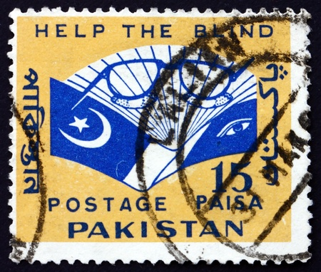 PAKISTAN - CIRCA 1965: a stamp printed in Pakistan shows Eyeglasses and Book, Aid for the Blind, circa 1965 Stock Photo - 17950716