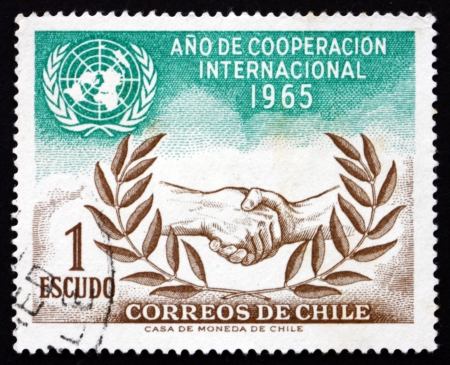 un used: CHILE - CIRCA 1966: a stamp printed in the Chile shows UN and ICY Emblems, International Cooperation Year, circa 1966
