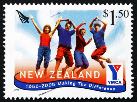 NEW ZEALAND - CIRCA 2005: a stamp printed in the New Zealand shows Four People Jumping, YMCA Emblem, Community Groups, circa 2005