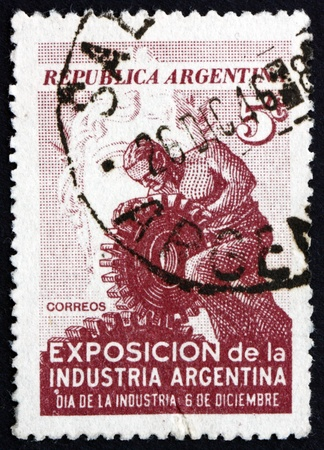 postage stamp: ARGENTINA - CIRCA 1946: a stamp printed in the Argentina shows Worker with Gear, Day of Argentine Industry, circa 1946 Editorial