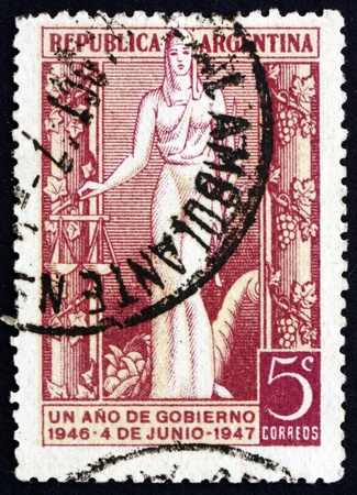 peron: ARGENTINA - CIRCA 1947: a stamp printed in the Argentina shows Justice, 1st Anniversary of the Peron Government, circa 1947