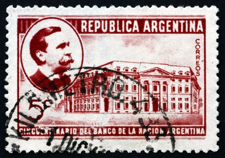 founding: ARGENTINA - CIRCA 1941: a stamp printed in the Argentina shows Carlos Pellegrini and Bank of the Nation, 50th Anniversary of the Founding, circa 1941