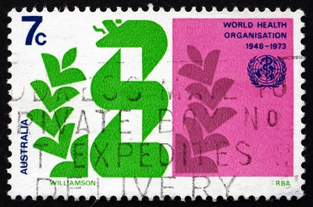 AUSTRALIA - CIRCA 1973: a stamp printed in the Australia shows Stylized Caduceus and Laurel, 25th Anniversary of the WHO, circa 1973