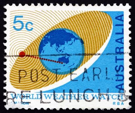 observations: AUSTRALIA - CIRCA 1968: a stamp printed in the Australia shows Satellite Orbiting Earth, Use of Satellites for Weather Observations and Communications, circa 1968