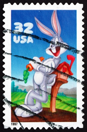 bugs bunny: UNITED STATES OF AMERICA - CIRCA 1997: a stamp printed in the USA shows Bugs Bunny, Animal Cartoon Character, circa 1997