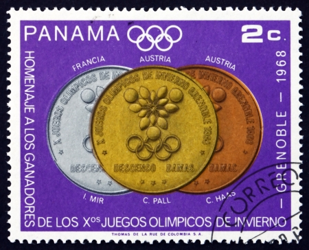 PANAMA - CIRCA 1968: a stamp printed in the Panama shows Women�s Downhill, Olympic Medals and Winners, Grenoble, circa 1968