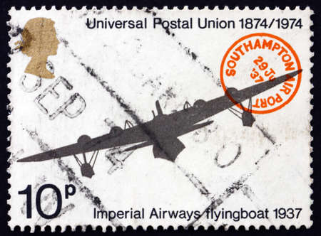 upu: GREAT BRITAIN - CIRCA 1974: a stamp printed in the Great Britain shows Imperial Airways Flying Boat and Southampton Airport Postmark, Centenary of UPU, circa 1974