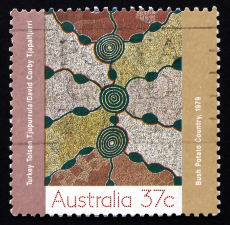 AUSTRALIA - CIRCA 1988: a stamp printed in the Australia shows Bush Potato Country, Aboriginal Painting from Papunya Settlement, circa 1988