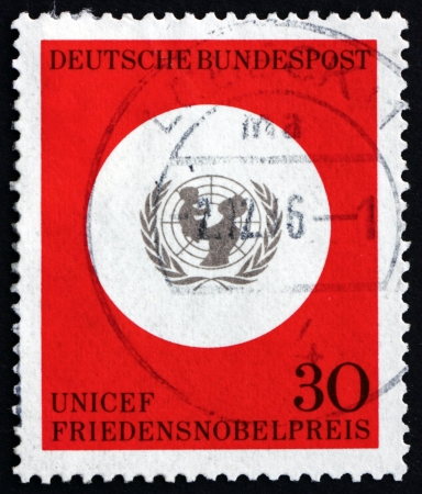 awarding: GERMANY - CIRCA 1995: a stamp printed in the Germany shows UNICEF Emblem, Awarding of the 1965 Nobel Peace Prize to UNICEF, circa 1995