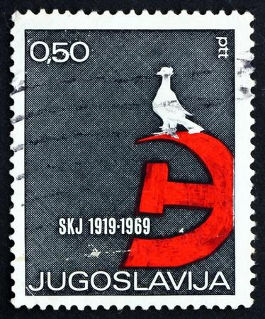 yugoslavia: YUGOSLAVIA - CIRCA 1969: a stamp printed in the Yugoslavia shows Dove, Hammer and Sickle Emblem, 50th Anniversary of Communist Federation of Yugoslavia, circa 1969