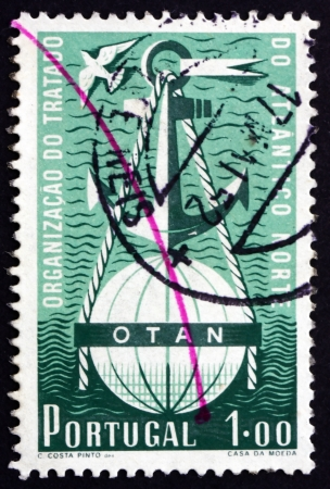 treaty: PORTUGAL - CIRCA 1952: a stamp printed in the Portugal shows Symbolical of NATO, 3rd Anniversary of Signing of North Atlantic Treaty, circa 1952
