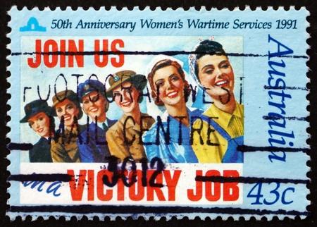 wartime: AUSTRALIA - CIRCA 1991: a stamp printed in the Australia shows Women's Wartime Services, 50th Anniversary, circa 1991 Editorial
