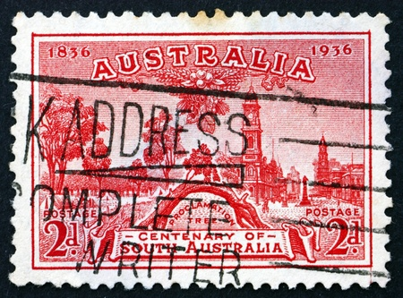 proclamation: AUSTRALIA - CIRCA 1936: a stamp printed in the Australia shows Proclamation Tree and View of Adelaide, Centenary of South Australia, circa 1936