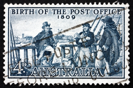 postmaster: AUSTRALIA - CIRCA 1959: a stamp printed in the Australia shows Postmaster Isaac Nichols Boarding Vessel to Receive Mail, 150th Anniversary of the First Post Office, Sydney, circa 1959 Editorial