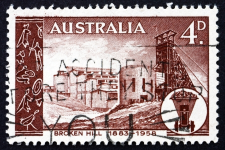commemorate: AUSTRALIA - CIRCA 1958: a stamp printed in the Australia shows Broken Hill Mine, 75th Anniversary of the Broken Hill Mining Field, circa 1958