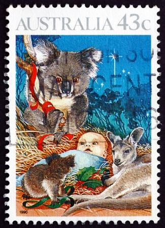 AUSTRALIA - CIRCA 1990: a stamp printed in the Australia shows Nativity, Child and Koala, Christmas, circa 1990