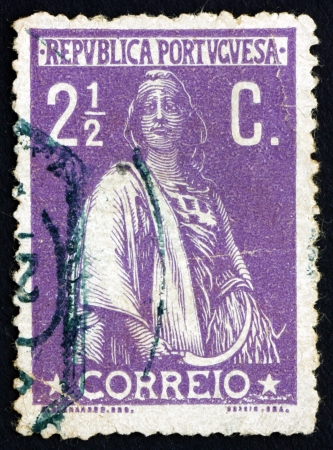 fertility goddess: PORTUGAL - CIRCA 1912: a stamp printed in the Portugal shows Ceres, Goddes of Agriculture, Grain Crops, Fertility and Motherly Relastionships, circa 1912