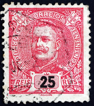 carlos: PORTUGAL - CIRCA 1899: a stamp printed in the Portugal shows King Carlos, King of Portugal, circa 1899 Editorial