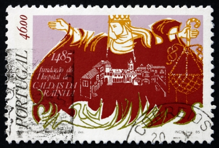 PORTUGAL - CIRCA 1985: a stamp printed in the Portugal shows Queen Leonor Founding the Caldas da Rainha Hospital, circa 1985