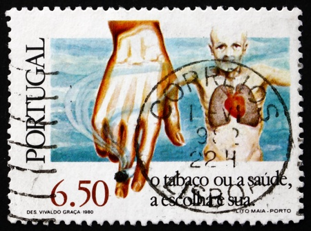 diseased: PORTUGAL - CIRCA 1980: a stamp printed in the Portugal shows Man with Diseased Heart and Lungs, Hand Holding Cigarette, Anti-smoking Campaign, circa 1980