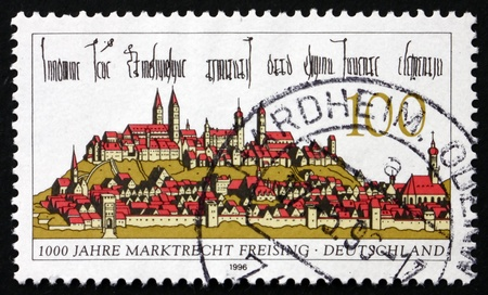 freising: GERMANY - CIRCA 1996: a stamp printed in the Germany shows Freising, Town in Bavaria, 1000th Anniversary of Freising's Right to Hold Markets, circa 1996
