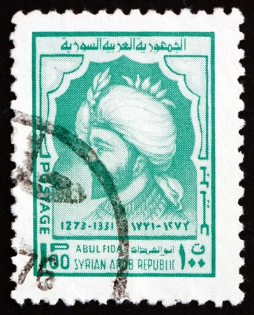 SYRIA - CIRCA 19674 a stamp printed in the Syria shows Abul Fida Ismail Hamwi, Abulfeda, Historian, Geographer and Lokal Governor of Hamah, Syrian Prince, circa 1974 Stock Photo - 18833207