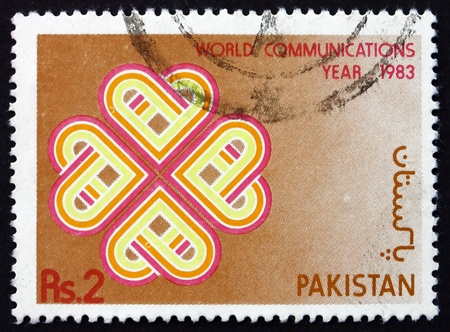 PAKISTAN - CIRCA 1983: a stamp printed in Pakistan shows Sign, World Communications Year, circa 1983 Stock Photo - 18833220