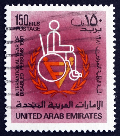UNITED ARAB EMIRATES - CIRCA 1981: a stamp printed in the UAE shows Man in Wheelchair, International Year of the Disabled, circa 1981