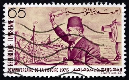 TUNISIA - CIRCA 1975: a stamp printed in Tunisia shows Habib Bourguiba Arriving at La Goulette, Tunis, 20th Anniversary of Independence, circa 1975 Stock Photo - 18833218