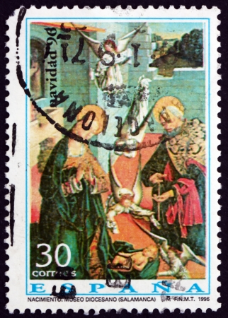 SPAIN - CIRCA 1992: a stamp printed in the Spain shows Birth of Christ, Painting by Fernando Gallego, Christmas, circa 1992 Stock Photo - 18883936
