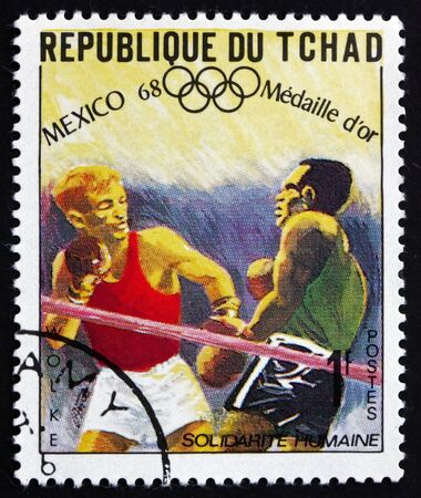 chadian: CHAD - CIRCA 1969: a stamp printed in Chad shows Manfred Wolke, Welterweight, Boxing, Winner of 1968 Olympic Games, Mexico, circa 1969