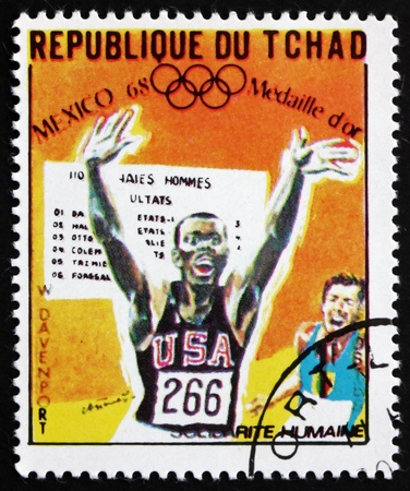 davenport: CHAD - CIRCA 1969: a stamp printed in Chad shows Willie Davenport, 110m Hurdles, Running, Winner of 1968 Olympic Games, Mexico, circa 1969 Editorial
