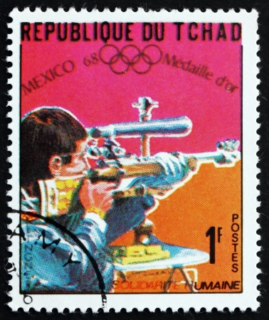 chadian: CHAD - CIRCA 1969: a stamp printed in Chad shows Bernd Klinger, Small Bore Rifle, Shooting, Winner of 1968 Olympic Games, Mexico, circa 1969