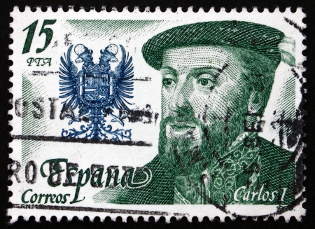 SPAIN - CIRCA 1979: a stamp printed in the Spain shows Carlos I and Coat of Arms, King of the House of Austria (Hapsburg Dynasty), circa 1979 Stock Photo - 18883940