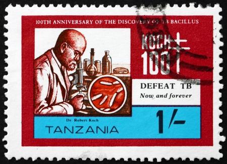 discoverer: TANZANIA - CIRCA 1982: un sello impreso en Tanzania muestra a Robert Koch, descubridor del bacilo de la tuberculosis, alrededor de 1982 Editorial
